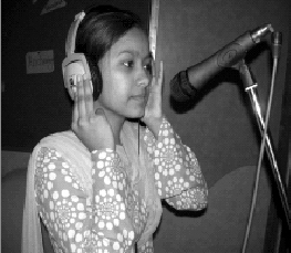 A 19 year-old woman from Shahbad, Daulatpur, a resettlement colony in North West Delhi in India is among the people behind a radio programme on disaster management, broadcast through the studio of One World South Asia. Photo by One World South Asia