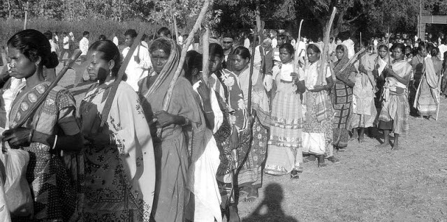 With their traditional weapons, Adivasi women join a huge mobilisation at Chakadoba village in Medinipur district of West Bengal, India.